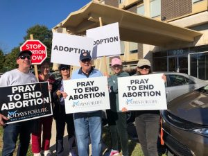 Group of people holding anti-abortion signs